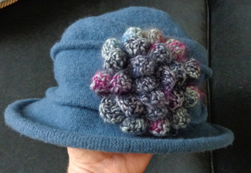 camellia crocheted by Deborah Cooke on the hat