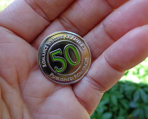 Deborah Cooke's 50 books published pin from RWA