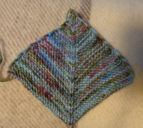 Mitred square in sock yarn knit by Deborah Cooke