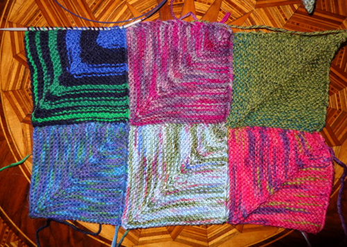 Mitred squares knit in sock yarn by Deborah Cooke