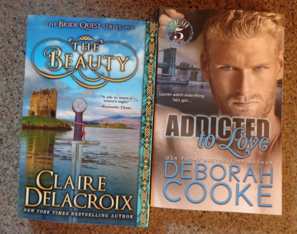 The Beauty, a medieval Scottish romance by Claire Delacroix, and Addicted to Love, a contemporary romance by Deborah Cooke, in print editions