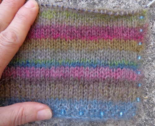 Earth Stripe Wrap in progress, knitted by Deborah Cooke