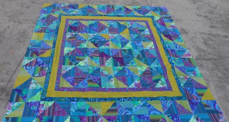 green quilt sewn by Deborah Cooke