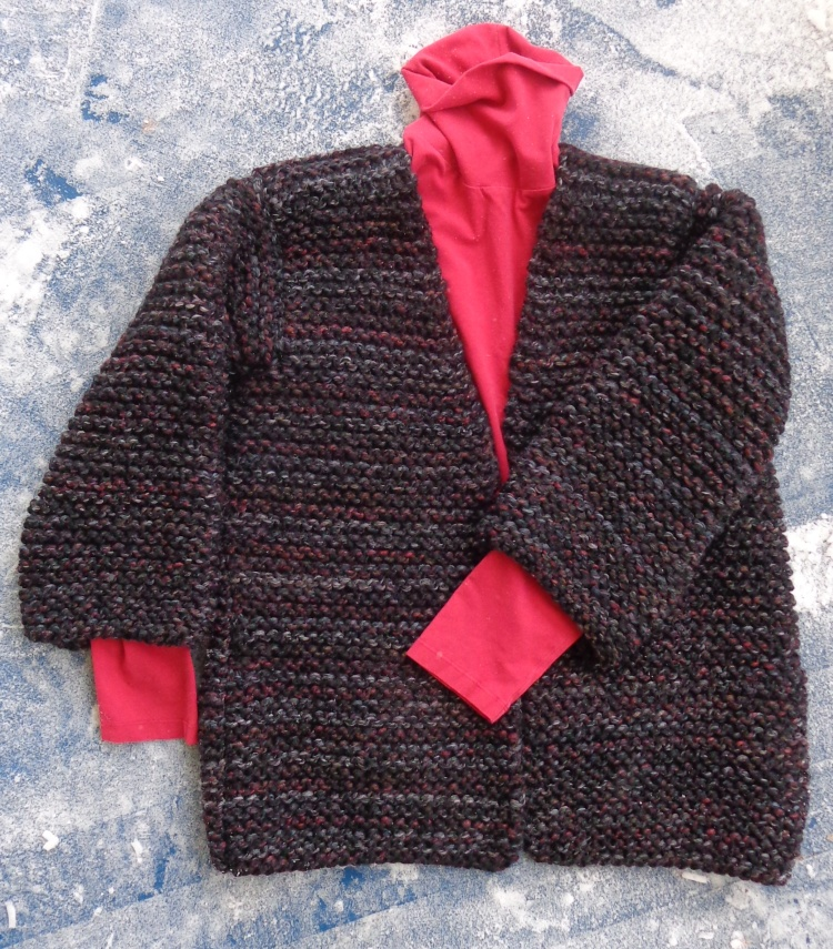 Black cardigan knit by Deborah Cooke