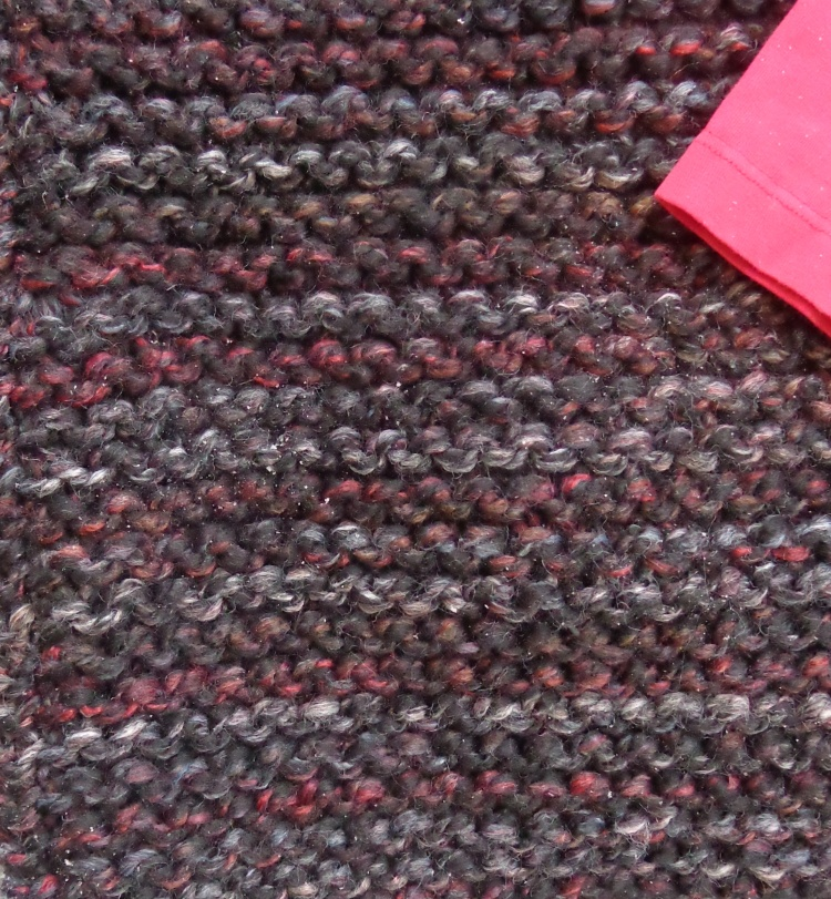 detail of Black cardigan knit by Deborah Cooke
