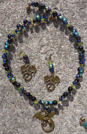 Dragon pendant and earrings with blue glass made by Deborah Cooke