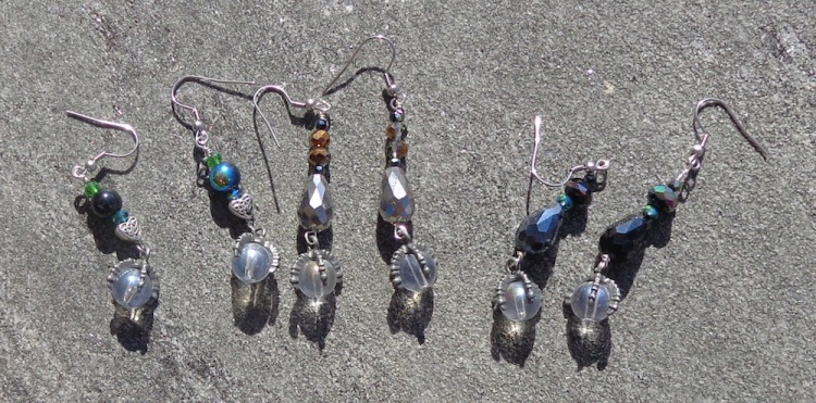 Dragon claw drop earrings with glass beads made by Deborah Cooke