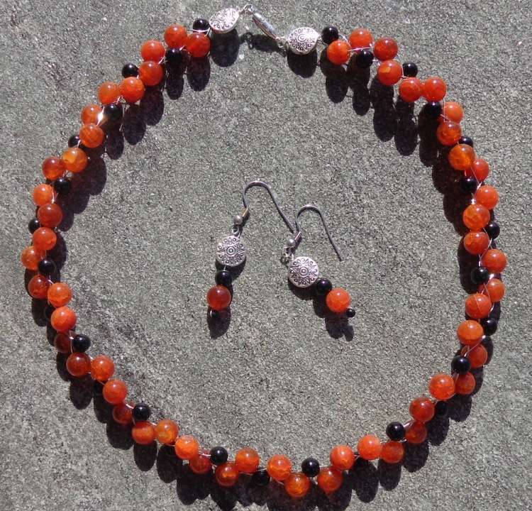 Fire agate necklace and earrings made by Deborah Cooke