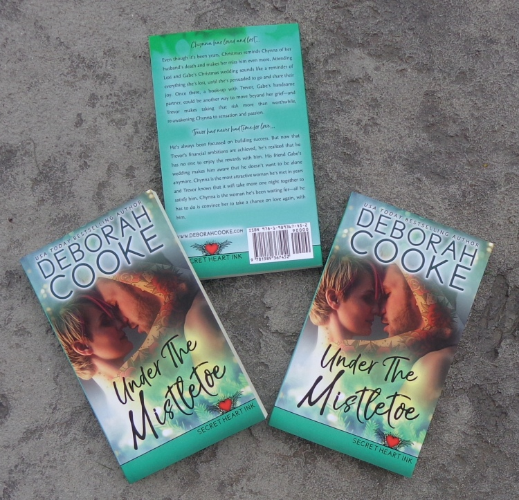 Under the Mistletoe, book four of the Secret Heart Ink series of contemporary romances by Deborah Cooke